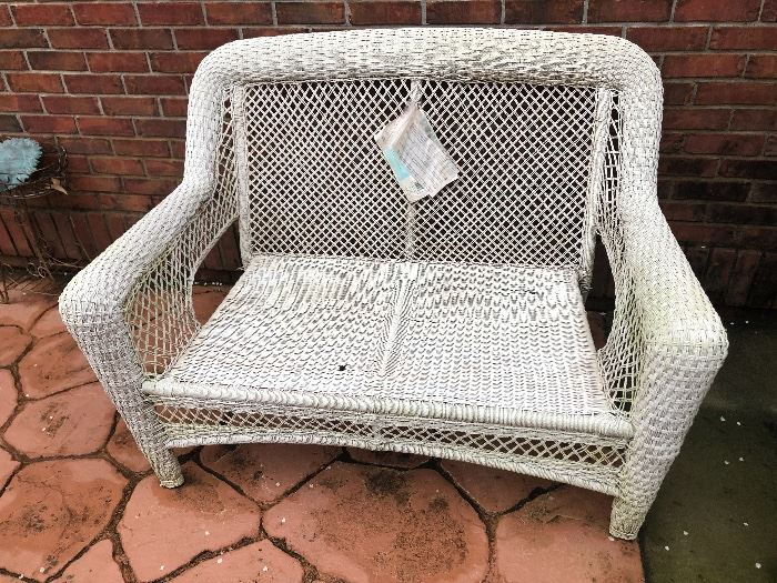 a white wicker settee. sturdy. has original tags. just needs a quick spray of paint and it will be like new