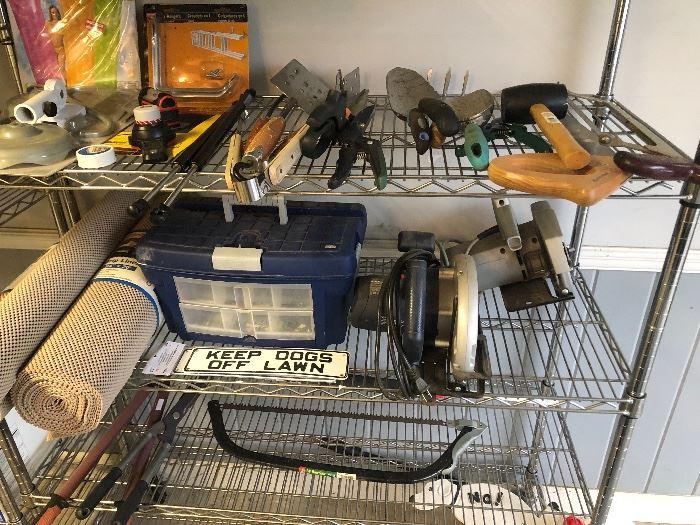 a shelf full of outdoor tools
