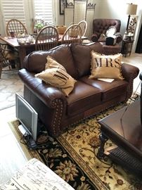 Another view of the family room and the leather love seat