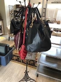 Quite a selection of designer purses. Some with tags. Some never used