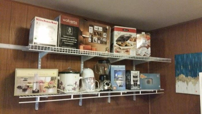 New in box - food processor, ice grinder, pictures, Cardinals toaster, drink maker - also a crock pot & Oster blender