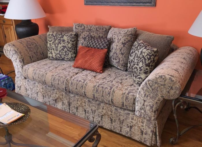 Another sofa with glass & iron coffee & end tables