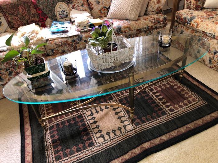 Oval glass/brass coffee table
