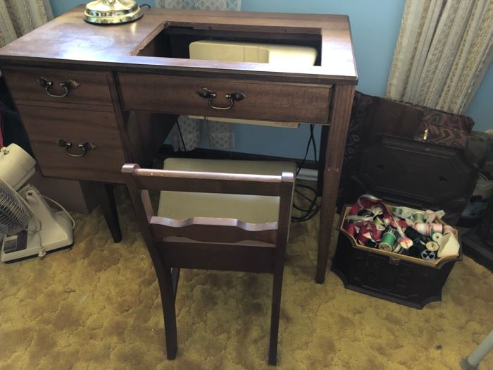 Singer sewing machine and cabinet with storage chair..
