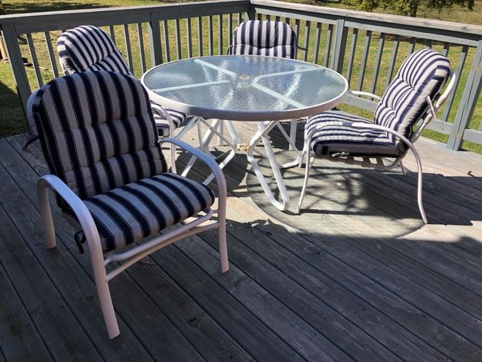 Patio table with chairs and pads