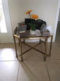 JUST REDUCED TO $25!  Glass top table.  (Does not include items on it.)                                                                                                                                                                                                  All items MUST be picked up on March 21st or 22nd only.  If you are unable to do this please email rcullen@virtualparalegalny.com PRIOR to purchasing. Sale has a house full of items available for sale, you are welcome to shop when you pick up your purchased items.  Lots of home decor, 2 closets FULL of ladies clothes and shoes, all like new and name brand, garage stuff, kitchen stuff etc.                                                                                                          GREAT PRICES!.