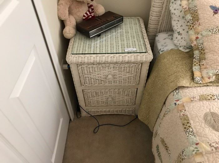 $25.  Wicker bedside table.    All items MUST be picked up on March 21st or 22nd only.  If you are unable to do this please email rcullen@virtualparalegalny.com PRIOR to purchasing. Sale has a house full of items available for sale, you are welcome to shop when you pick up your purchased items.  Lots of home decor, 2 closets FULL of ladies clothes and shoes, all like new and name brand, garage stuff, kitchen stuff etc. GREAT PRICES!