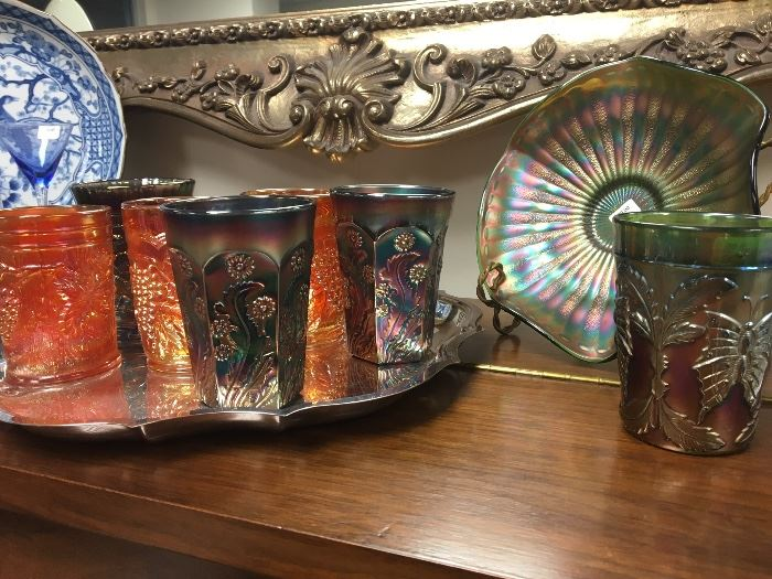 Collection of various patterns and colors of carnival glass tumblers.  All are original as far as we can tell