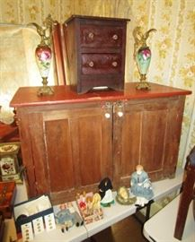 Primitive cupboard, primitive 2 drawer chest, antique porcelain handled pitchers w/ metal base/tops, collectible dolls/doll parts