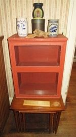 primitive cabinet w/ glass door, Manchester advertising stoneware, misc. decor, stacking tables (3)