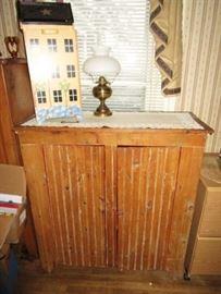Primitive cupboard, kerosene lamp, decor