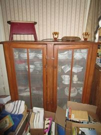 Primitive cabinet, porcelain dinnerware, figurines to be discovered, vintage & modern books, wooden stool