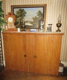 Primitive cupboard, paintings, antique mantle clock, kerosene lamps
