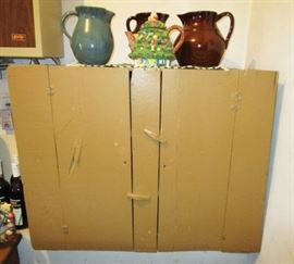 Primitive painted cupboard, stoneware pitchers