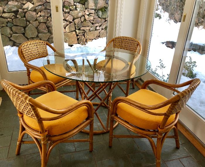 Fabulous Vintage McGuire Bamboo and Rattan Patio Set feat. glass top table, and 4 chairs.