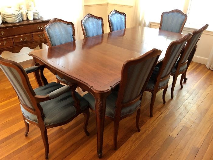 "Kindel Dining Room Table, Chairs, and China Cabinet - hidden leaves expand to 96""."