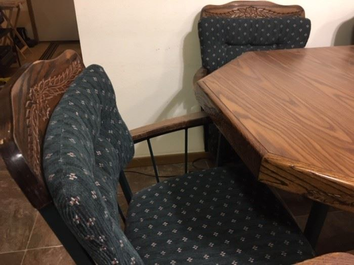 Octagonal table plus 4 rocker/rolling chairs plus large leaf