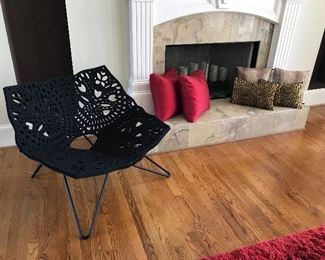 Steel butterfly chair with a thick felt cushion.