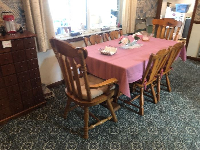 Solid wood table and six chairs.
