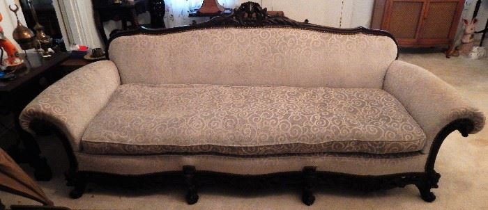 Although settee appears lighter, it is the same color as chair in next picture.