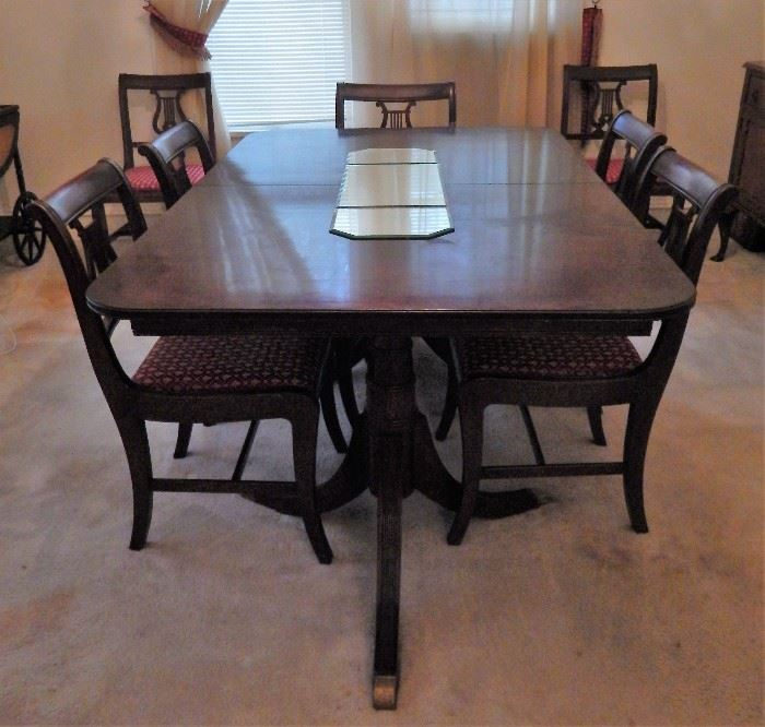 Thomasville double pedestal table with 8 chairs and 3 leafs