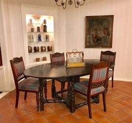 Antique drop side gate legged table and custom upholstered antique carved mahogany dining chairs, antique tapestry, tantalus, stein collection, antique cracker barrels