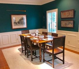 Antique oak dining table and oak leather dining chairs, antique prints
