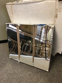 Mirrored medicine cabinet (bottom corner has a chip)