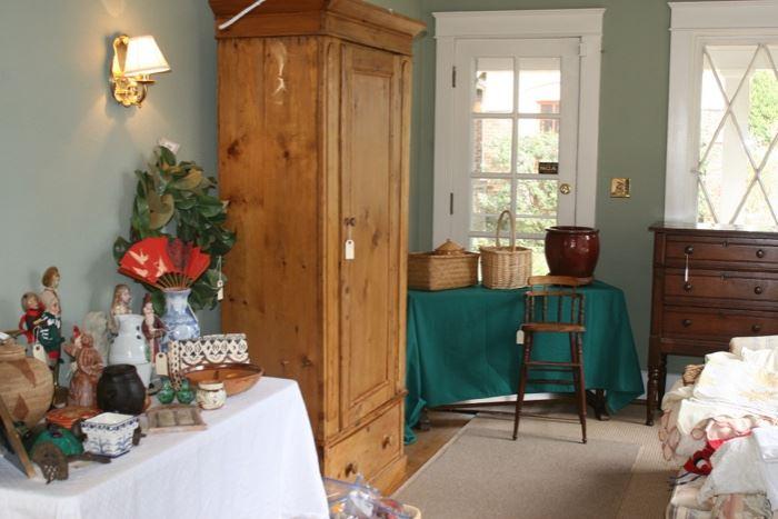 Pine wardrobe, dresser and child's antique high chair; linens