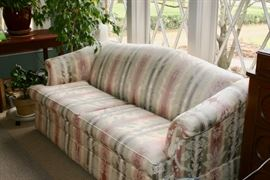 This is Norwalk couch (6 ft), hide abed; believe bed never used.  This couch sits in sunroom which has muted the colors some; slight worn area on back of couch; we use a throw on the back