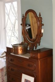 Oak dresser with ornate mirror and marble top