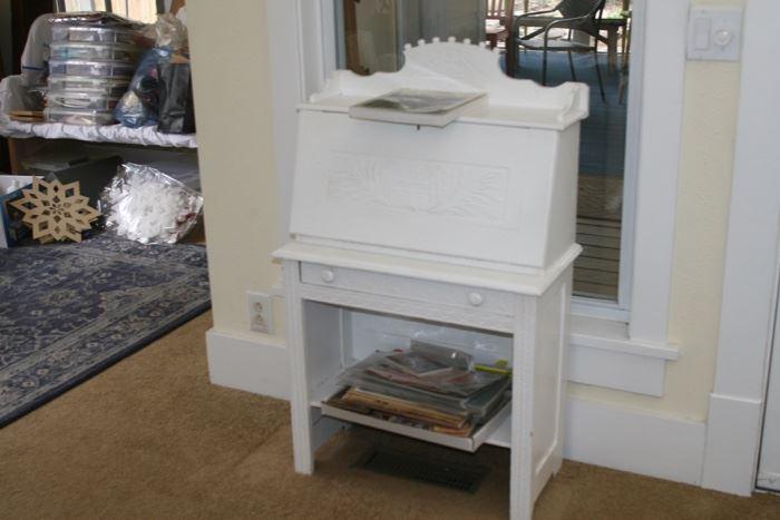 Small white, child's size desk; craft supples