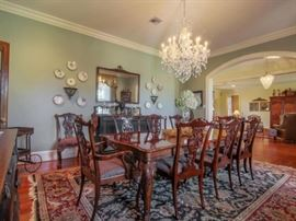 Henredon dining room table with 10 chairs--notice the hand knotted wool rug that's 10' by 14'