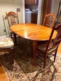Great hand hewn kitchen/ dining set w extra leaf 4 chairs