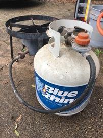 Propane burner and propane bottle.