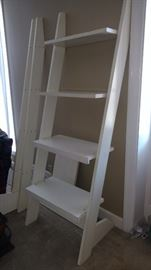 """One section of a 3 section leaning shelf unit. Completely assembled it would be approximately 84"""" long and 78"""" tall with a total of 12 shelves"""