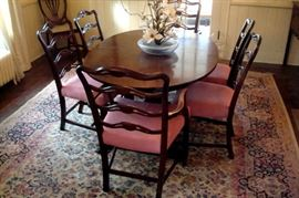 Duncan Phyfe extension dining table and six Chippendale style chairs.