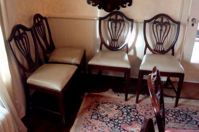 Four Federal shield back chairs.