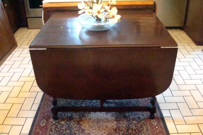 Antique cherry drop leaf extension table.
