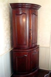 Mid 1800's half round mahogany china cabinet. Great item for a colonial home.