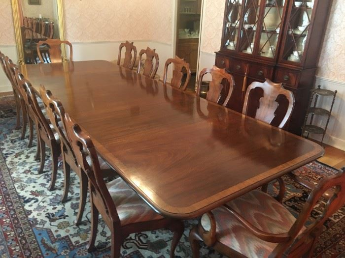 "Triple pedestal, mahogany, banded dining table with three leaves and table pad.  11'9"" long, 52"" wide.  One of the most beautiful dining tables we've ever offered. Seats 12 and has the Queen Anne Chairs."