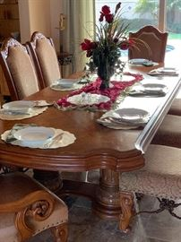 elegant dining table and chairs, leather with cloth 12 chairs