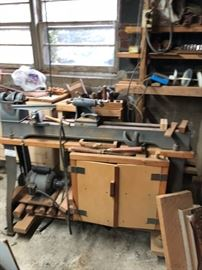 SMALL PART OF LARGE WOODWORKING SHOP IN BASEMENT