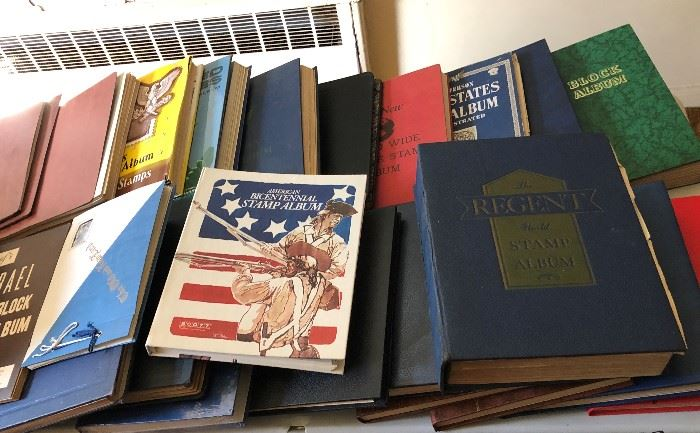 SOME OF THE MANY BOOKS FILLED WITH STAMPS