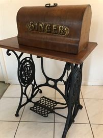 Antique Singer treadle sewing machine with cast iron base, parquetry table top and original cover