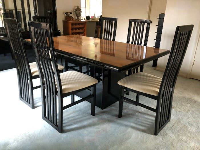 Modernist black lacquer/natural wood dining table with four chairs