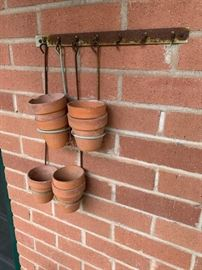 Small planting containers with hangers and hooks.