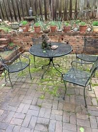 Outdoor wrought iron dining table and chairs.