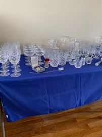 Large collection of Waterford crystal.  Water glasses, martini glasses, white wine, red wine, candle holders, pitcher and more.