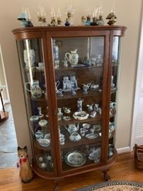 Large collection of collectible items including oil lamps and blue china.